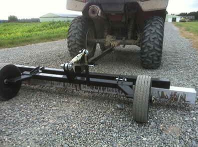 magnet-tow-behind-hog-series-showing-debris-picked-up-bluestreak-equipment
