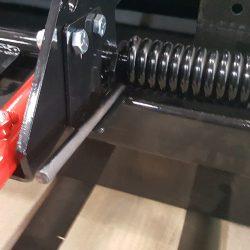 caiman spring assisted debris release lever