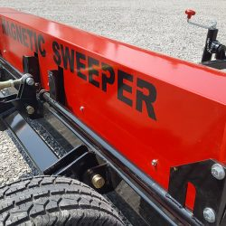 signage on the caiman magnetic sweeper