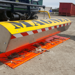 Cleaning off Yak magnet onto Orange Poly Debris Catcher