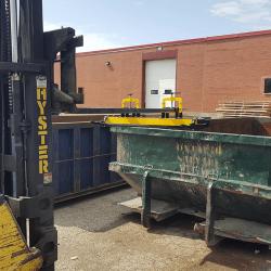 clean OBLAST forklift magnet off over dumpster