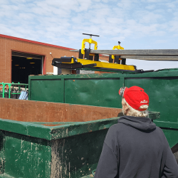 cleaning OBLAST magnetic sweeper off into scrap bin