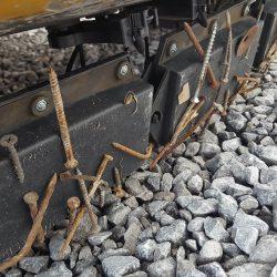 Nomic forklift magnet covered with debris