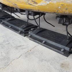 Nomic hanging magnet attached to underside forklift